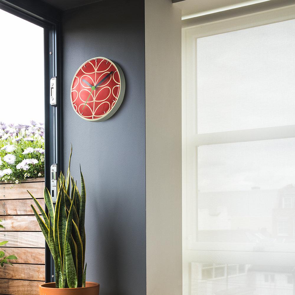 linear-stem-wall-clock-geranium-red